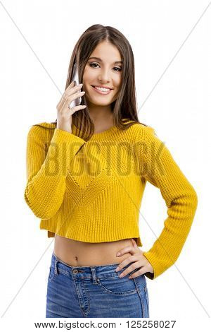 Beautiful girl making a phone call, isolated over white background