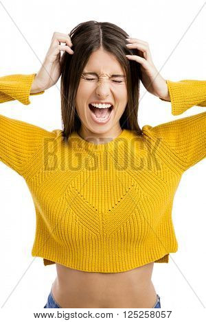 Portrait of a stressed young girl yelling