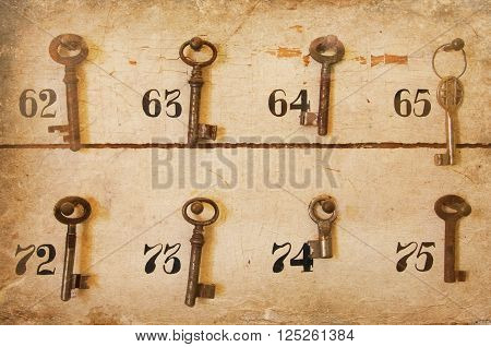 Vintage keys with numbers hanging in an old closet