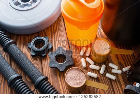 Shaker, Neck Dumbbells, Protein And Amino Acids On A Wooden Background