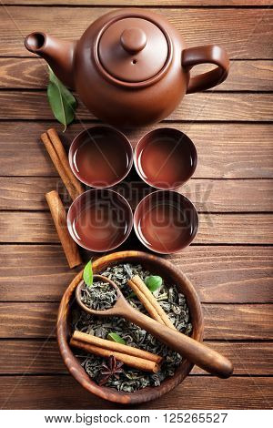 Green tea with ceramic utensils on wooden background