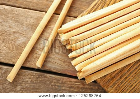 Stack of bread sticks on wooden table