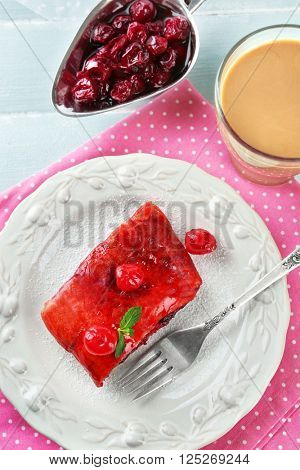 Cherry strudel with mint and cup of coffee