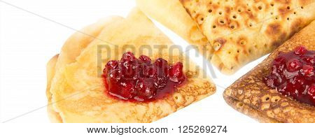 Pancakes put by a corner with cowberry jam
