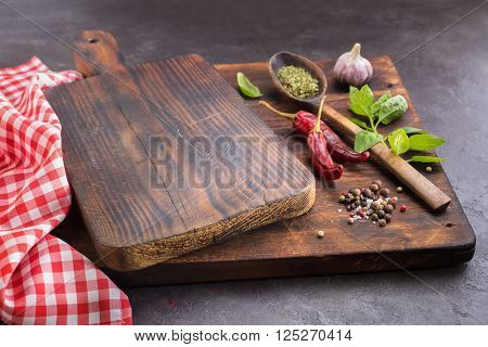 Cutting board and Spices. Hot peppers Basil Garlic and dried herbs. May be used as background
