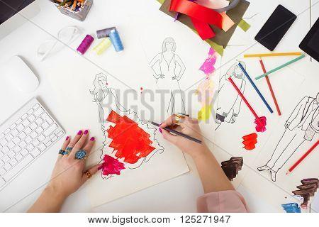 Fashion designer drawing a sketch for dress