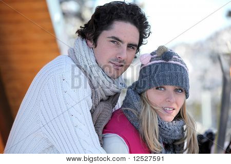 Portrait of a couple at the snow