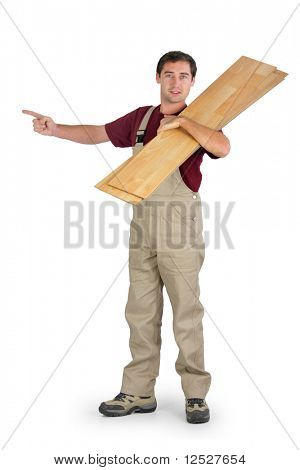Parquet layer carrying a board on his shoulder with white background