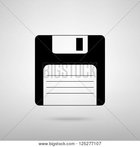 Floppy disk sign. Black with shadow on gray.