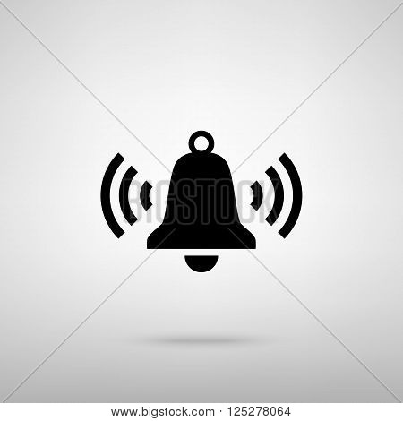 Ringing bell icon. Black with shadow on gray.