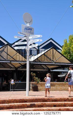 HILLARYS,WA,AUSTRALIA-JANUARY 22,2016: Signpost with tourists at Hillarys Boat Harbour in Hillarys, Western Australia.
