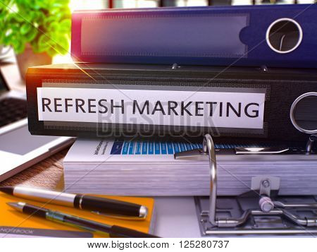 Refresh Marketing - Black Ring Binder on Office Desktop with Office Supplies and Modern Laptop. Refresh Marketing Business Concept on Blurred Background. 3D Render.