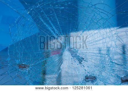 background broken glass from the bullets on facade building.