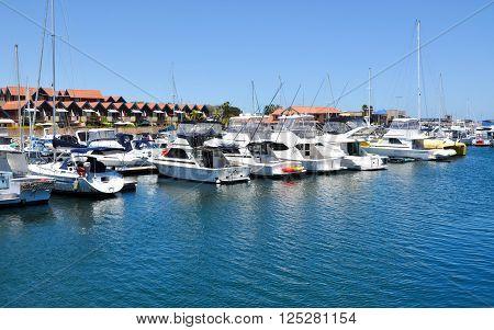 HILLARYS,WA,AUSTRALIA-JANUARY 22,2016: Yachts in the Marina in the boat pen at Hillarys Boat Harbour in Hillarys, Western Australia.