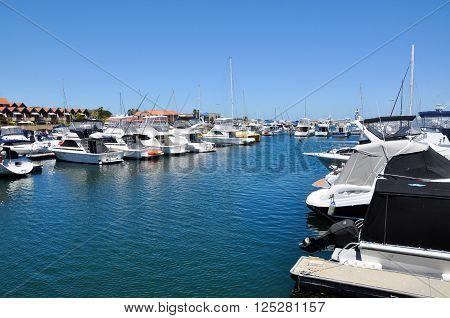 HILLARYS,WA,AUSTRALIA-JANUARY 22,2016: Yachts in the peaceful Marina at Hillarys Boat Harbour in Hillarys, Western Australia.
