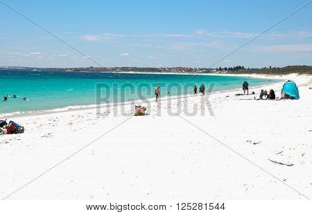 HILLARYS,WA,AUSTRALIA-JANUARY 22,2016: People relaxing on a sandy beach with the Indian Ocean waters in Hillarys, Western Australia.