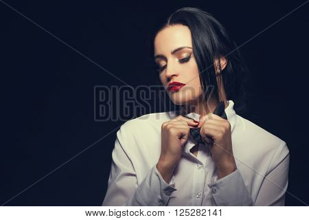 Woman undress tuxedo at night, sensuality and desire
