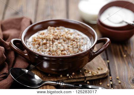 buckwheat porridge with milk in a bowl