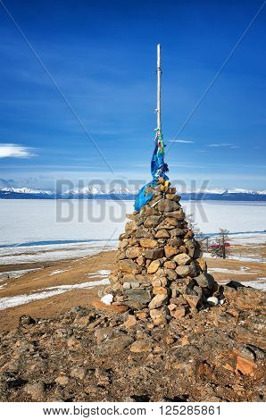 Buddhist cairn of clastic rocks on hill of Lake Hovsgol. Mongolia