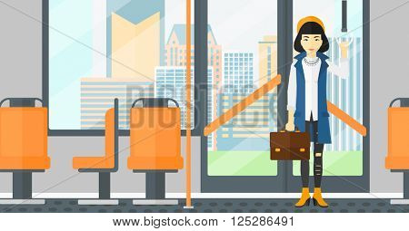 Woman standing inside public transport.