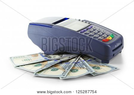 Credit card machine and dollar banknotes isolated on white