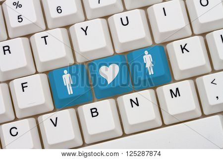 Internet Dating Sites A close-up of a keyboard with blue highlighted symbol of man and women and heart