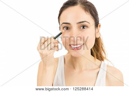 Caucasian attractive woman using eyeliner. Isolated on white background.