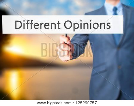 Different Opinions - Businessman Hand Holding Sign