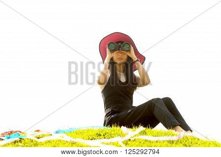 Pretty Asian young  woman sit on mound seeking Binoculars. ** Note: Soft Focus at 100%, best at smaller sizes