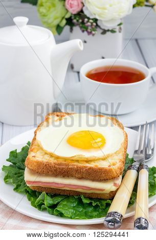 French toasted sandwich Croque madame on a plate, vertical