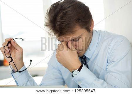 Tired Office Worker Touching His Bridge Of Nose To Give Rest To Eyes