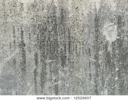 concrete texture with circular imprint on right
