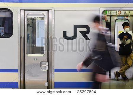 Tokyo, Japan - March 30, 2016: JR Commutor trains are the main mode of transportation in Tokyo.