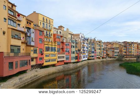 Facades of the old houses on the embankment of the river Onyar in Girona