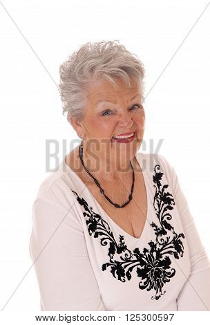 A lovely senior woman in her seventies in a portrait image smiling looking in camera isolated for white background.