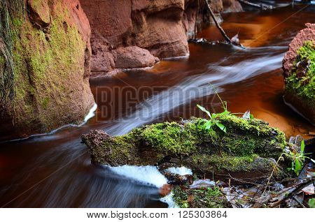 Small River Scene Among Rocky Valley