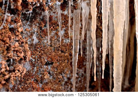 Pink And Orange Icicles Looking Like Stalactites Close-up. Shallow Depth Of Field