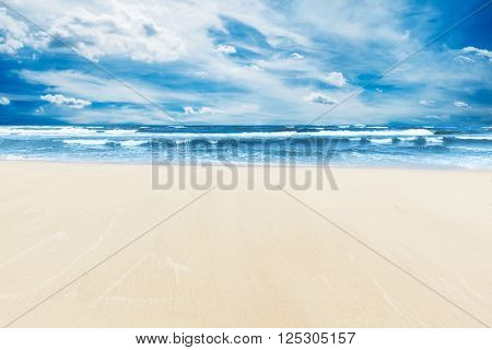 Summer beach and sea under sunny blue sky. A lot of copy-space, perfect for background