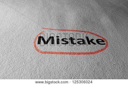 Closeup of Mistake text on paper circled in red pencil
