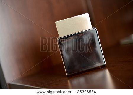 Men perfume sitting on shelf in natural light