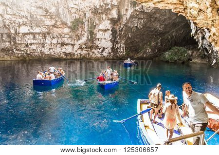 MELISSANI LAKE, KEFALONIA ISLAND, GREECE - August 9 2015: Boat with tourists visiting the cave. The lake of Melissani is inside a cave.