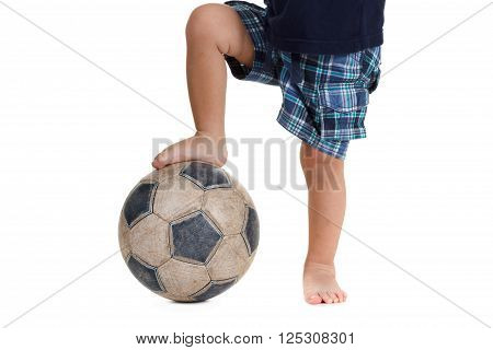 Soccer ball on the foot of a caucasian football player. Isolated on white background