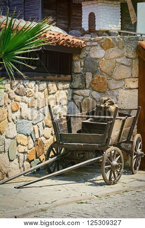 Cart with a Sack near the Stone Wall in Nessebar Bulgaria