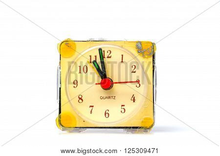 picture of a vintage damaged alarm clock on white