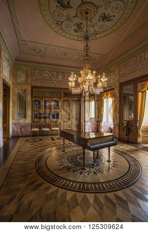 WEIMAR, GERMANY - APRIL 17, 2014: Famous Ceder room with a piano in the Stadtschloss (city castle) of Weimar, Thuringia, Germany