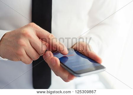 Male Hands Using Mobile Banking On Smartphone