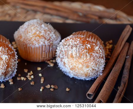 Delicious Homemade Vanilla Muffin With Chocolate And Grated Coconut On A Plate.