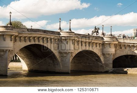 The pont Neuf is the oldest standing bridge across the river Seine in Paris.