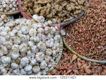 Garlic, ginger and shallots in baskets on a market in Kathmandu, Nepal