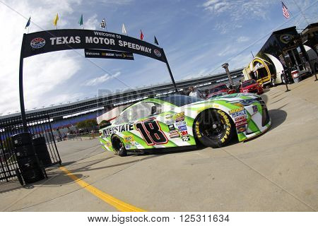 Ft. Worth, TX - Apr 07, 2016: Kyle Busch (18) brings his race car in for service during practice for the Duck Commander 500 at the Texas Motor Speedway in Ft. Worth, TX.